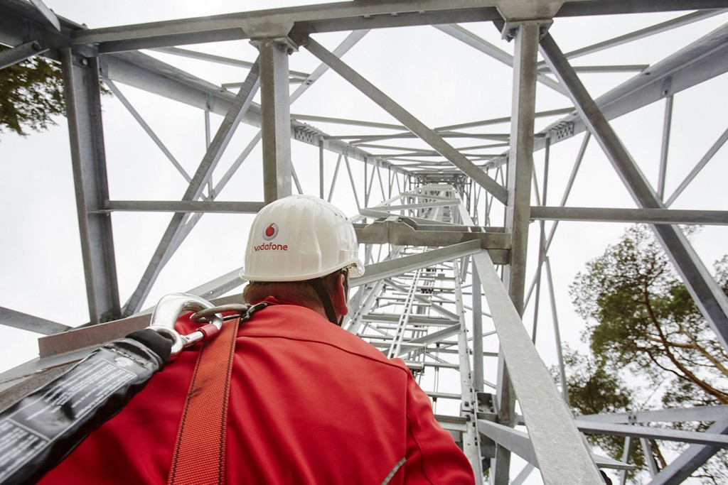 A Vodafone engineer at a network mast