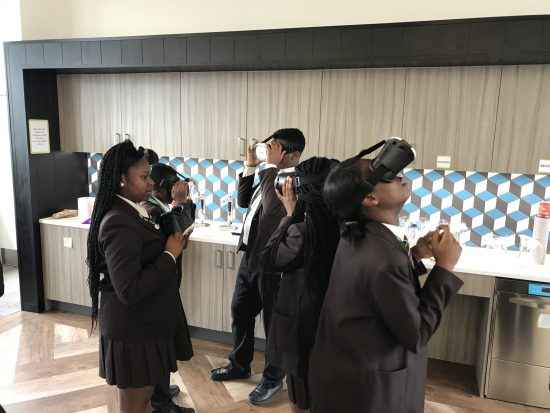 Pupils wearing VR headsets