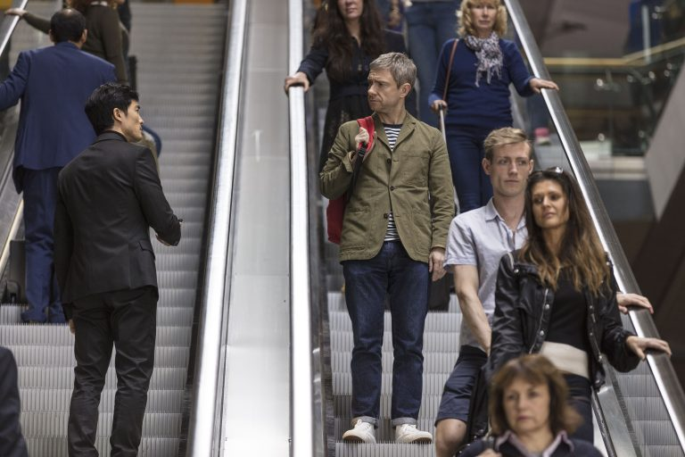 Martin Freeman is spotted by a mysterious stranger while going down an escalator