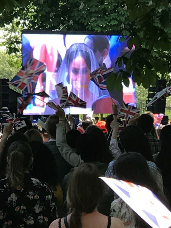 Photo of a crowd in Windsor watching the Royal Wedding and waving flags