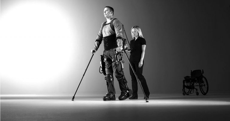 Photo of a man wearing an Ekso GT robotic exoskeleton