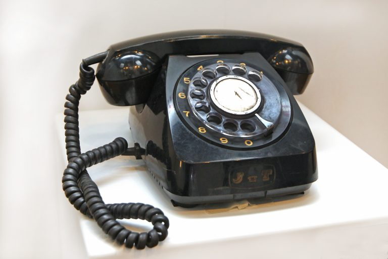 Old-style circular dial telephone