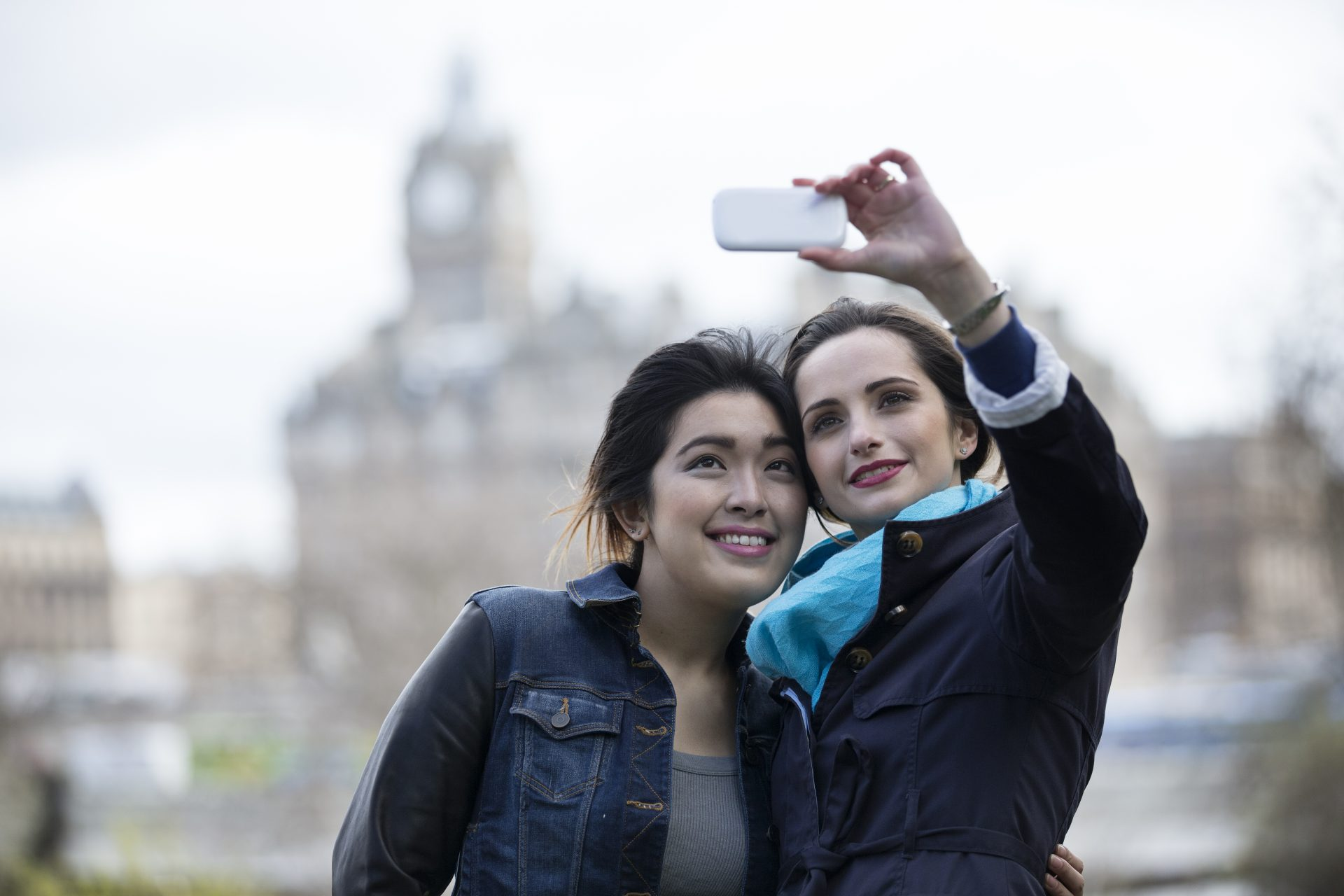 Two young women take a selfie in Edinburgh