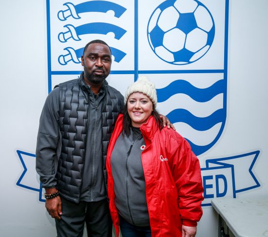 photo of Andrew Cole, Forward and Attack Coach for Southend United F.C., and Fiona McMahon, Vodafone's Southend-on-Sea City Manager