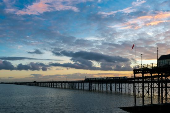 Southend pier at sunset with train