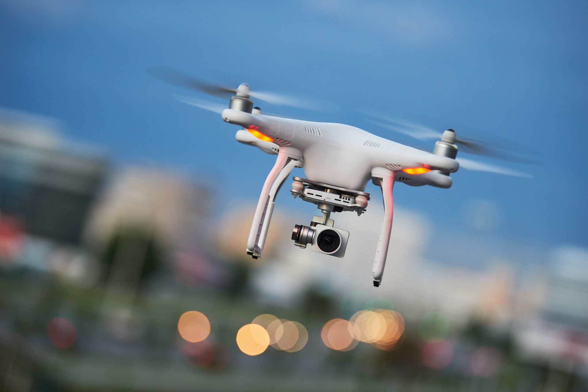 Flying quadcopter drone with digital camera