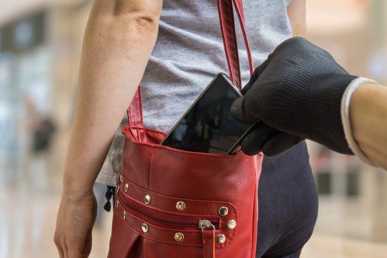Woman having smartphone stolen from her handbag