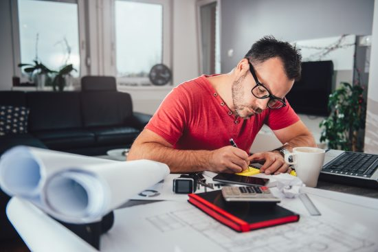 Man working at desk from home