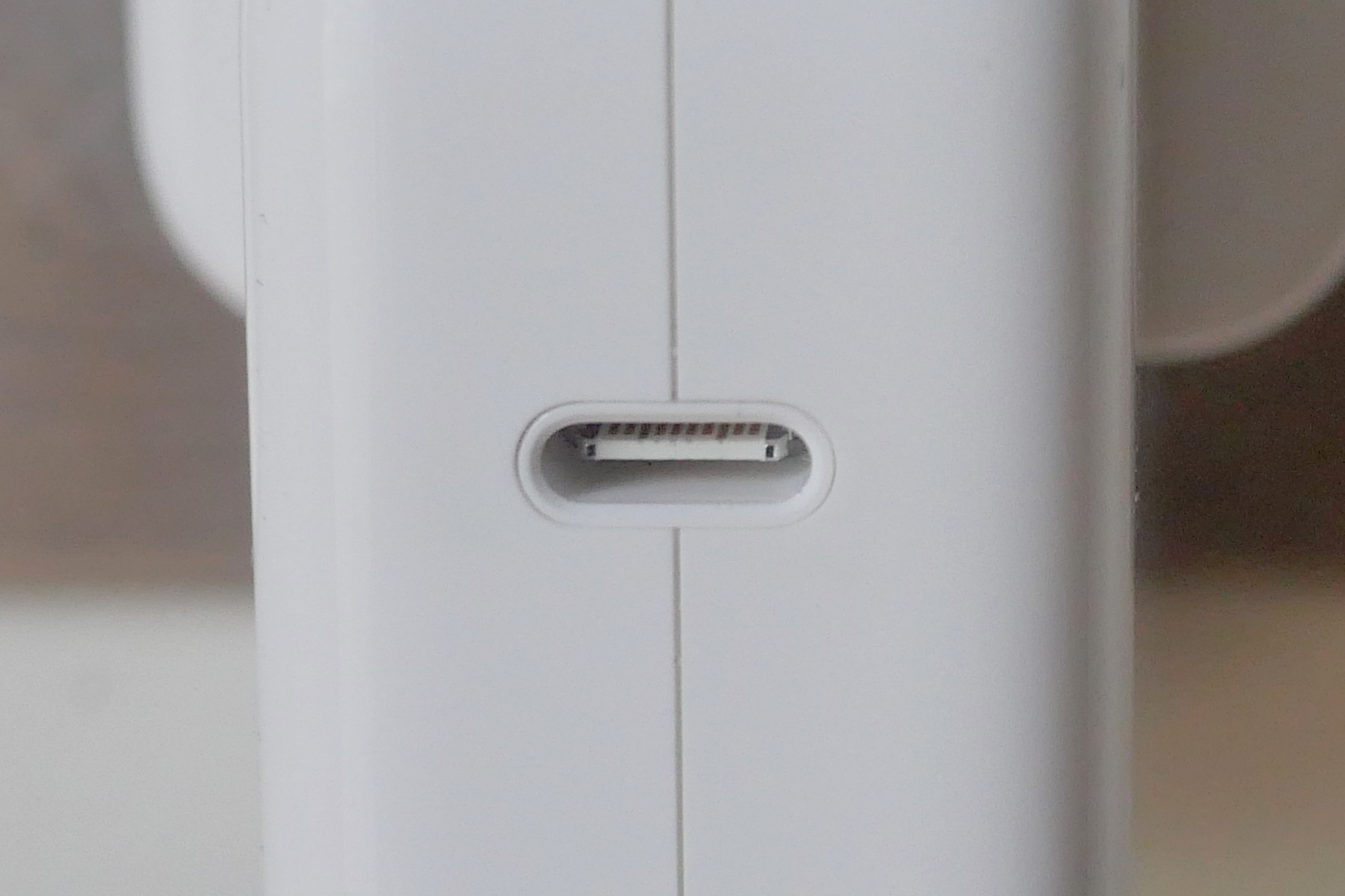 USB-C ports look very similar to Lightning ports, but they're distinguishable by the visible 'prong' - a common characteristic of all USB ports.