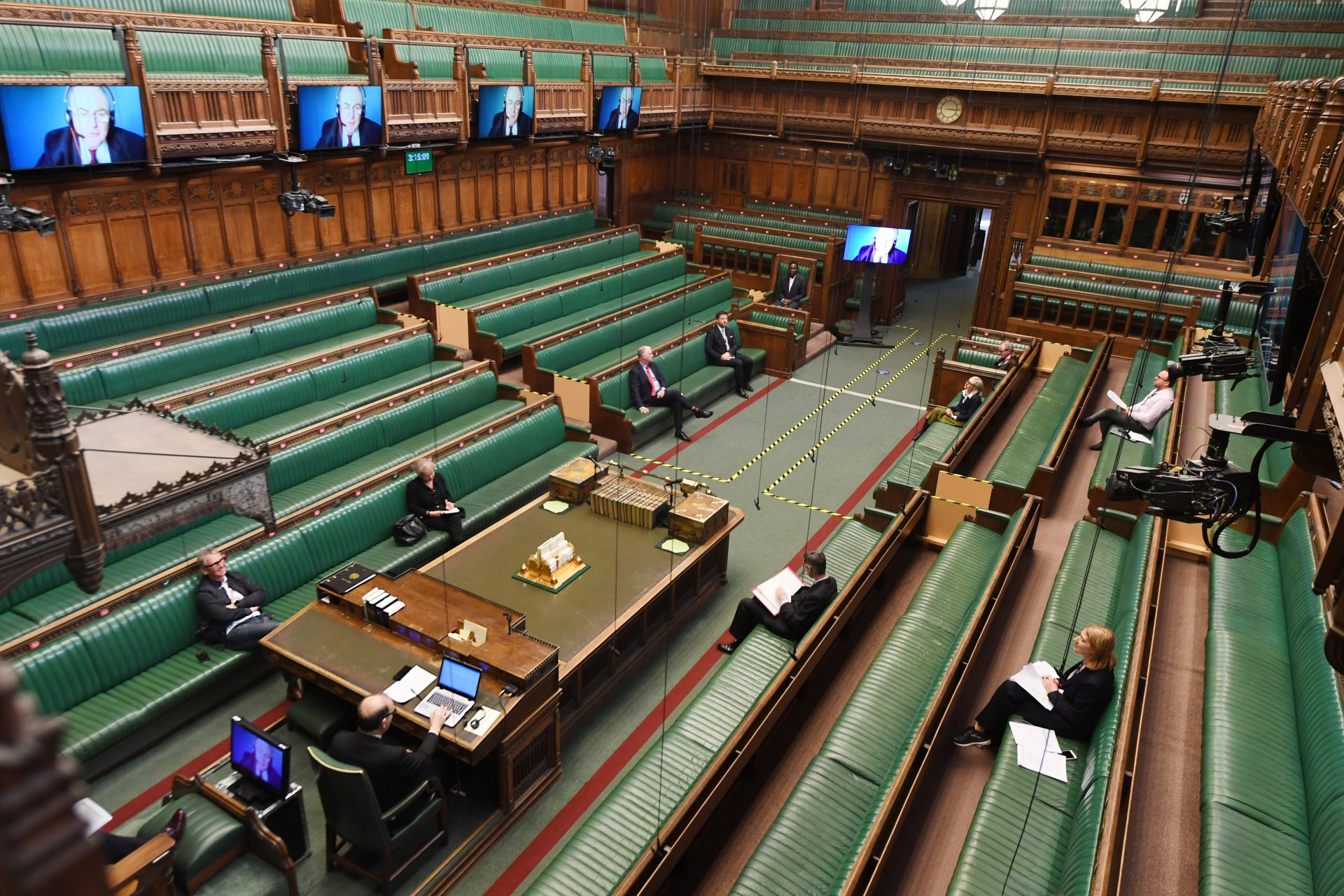 MPs remotely attend the House of Commons in a 'virtual parliament'