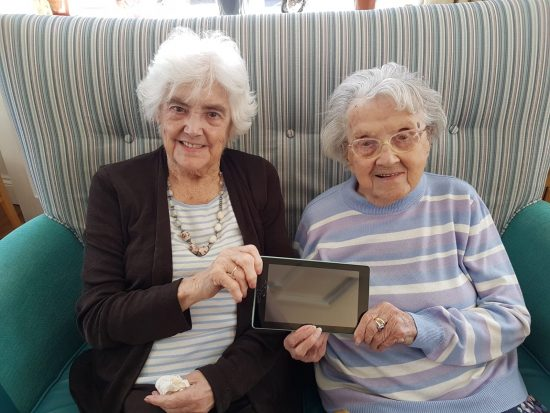 Two residents from Sandford Care Home with an iPad