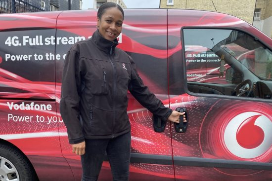 Natasha Carpenter Vodafone UK engineer standing in front of van