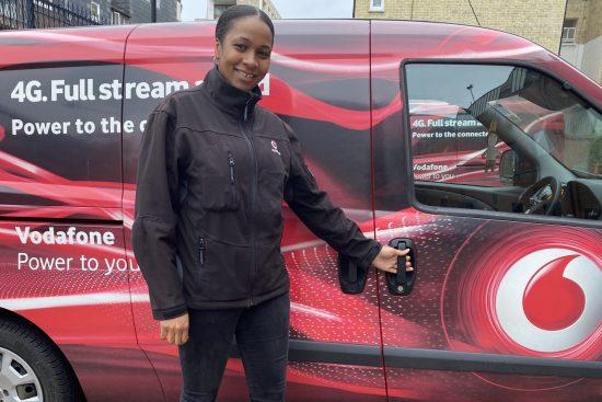 Natasha Carpenter Vodafone UK engineer standing in front of van