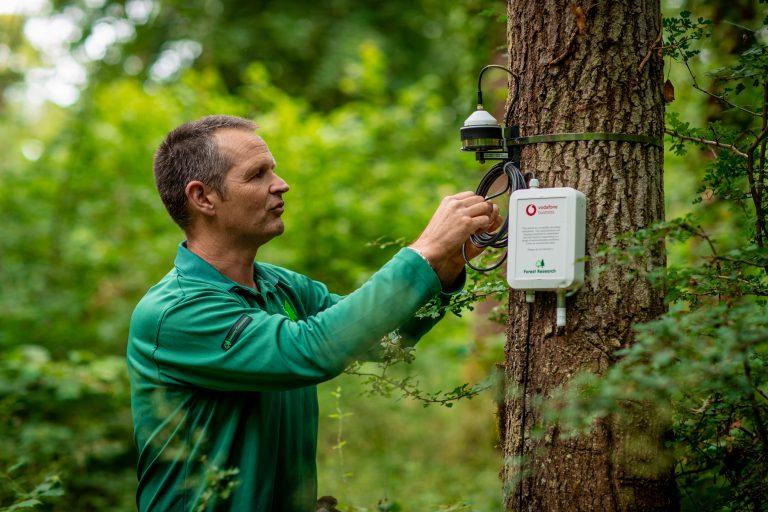 photo of Matthew Wilkinson and a Vodafone IoT sensor