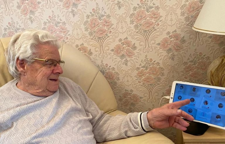 Elderly man operating Alcove Video Carephone