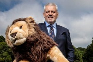Warren Gatland, Head Coach of the British & Irish Lions holding Bil, the team mascot