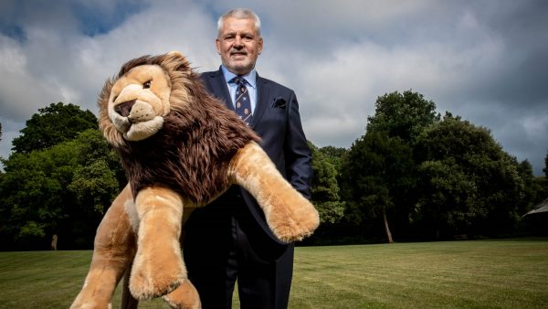 Warren Gatland, Head Coach of the British & Irish Lions holding Bil, the team mascot