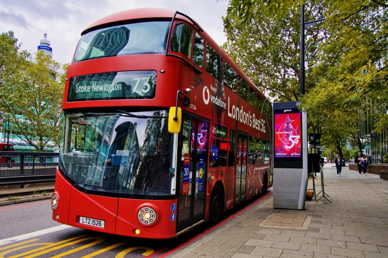 London Routemaster bus with Vodafone 'London's Best 5G' advertising and digital billboard