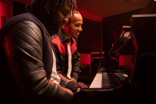 Lewis Hamilton & Jay Keys sitting at the piano