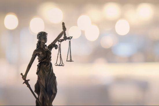 Statue of Justice against blurred background