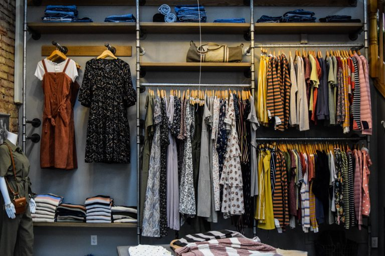 Open racks of clothes on display