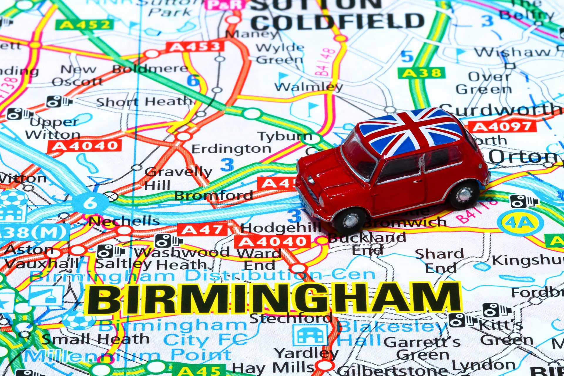 British toy Mini on map of Midlands