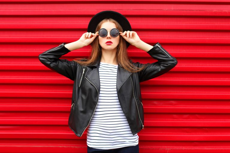 Young fashionable woman against red background