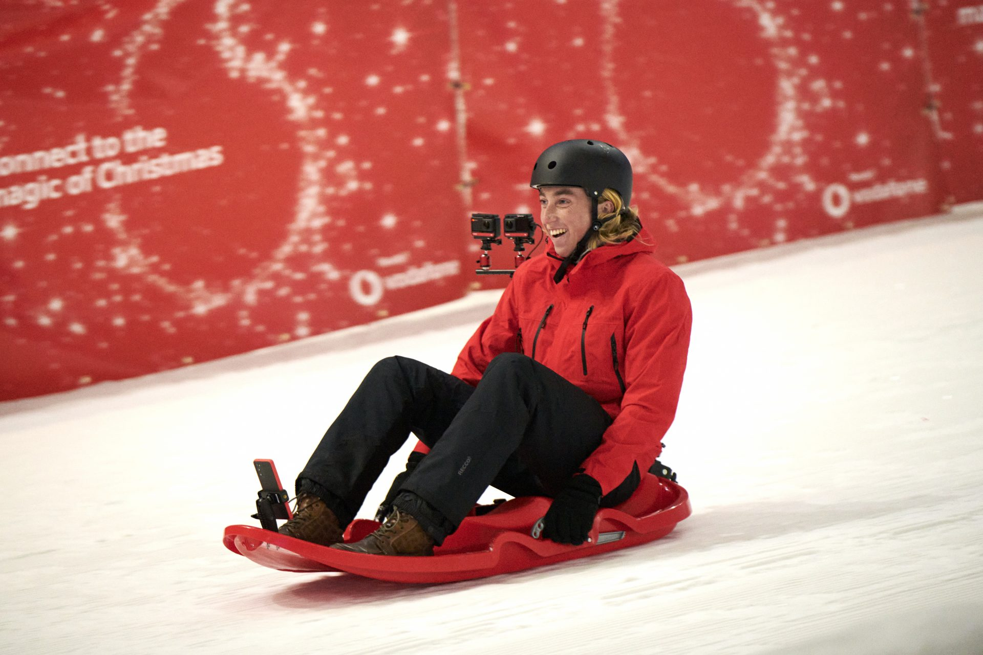 photo of Rory Dixon sledging on a specially-equipped Vodafone 5G bobsleigh.