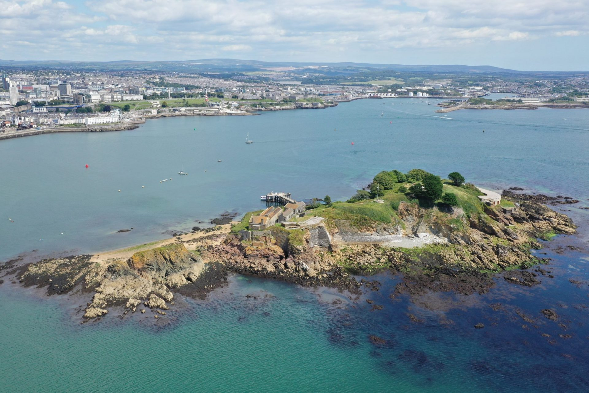 a photo of Plymouth Sound with Drake's Island in the foreground.
