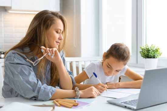 Mum and daughter homeschooling