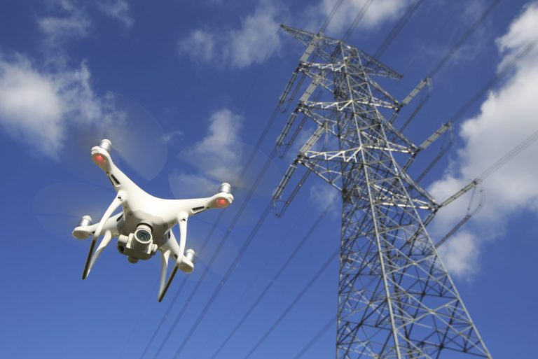 Drone inspecting electricity pylon
