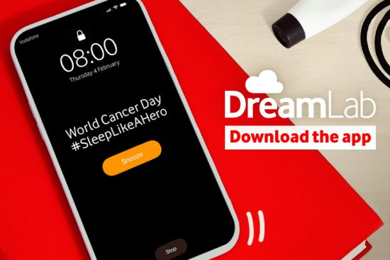 image of smartphone promoting World Cancer Day with the #SleepLikeAHero hashtag