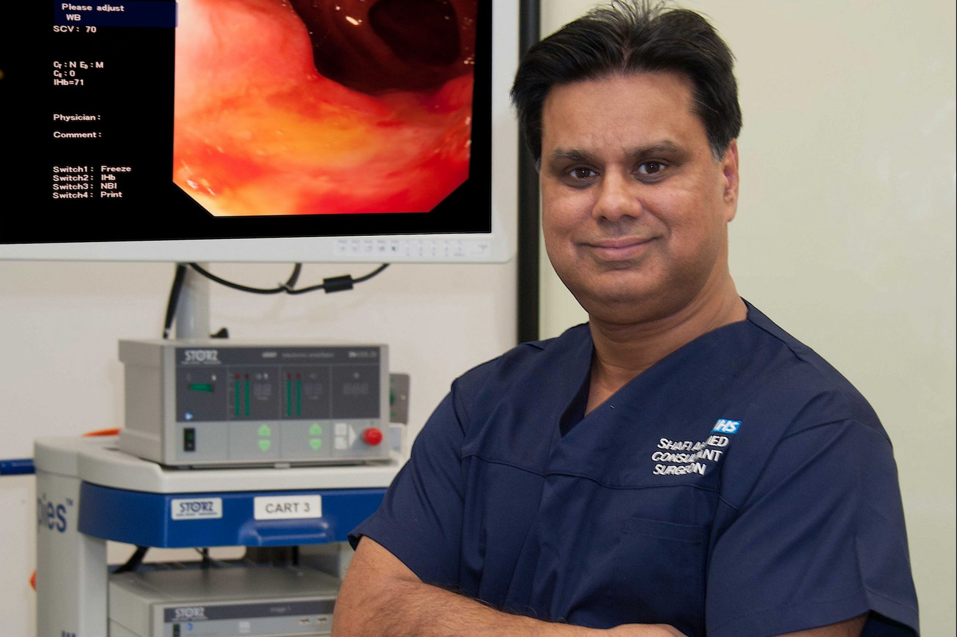 Prof Shafi Ahmed wearing hospital uniform