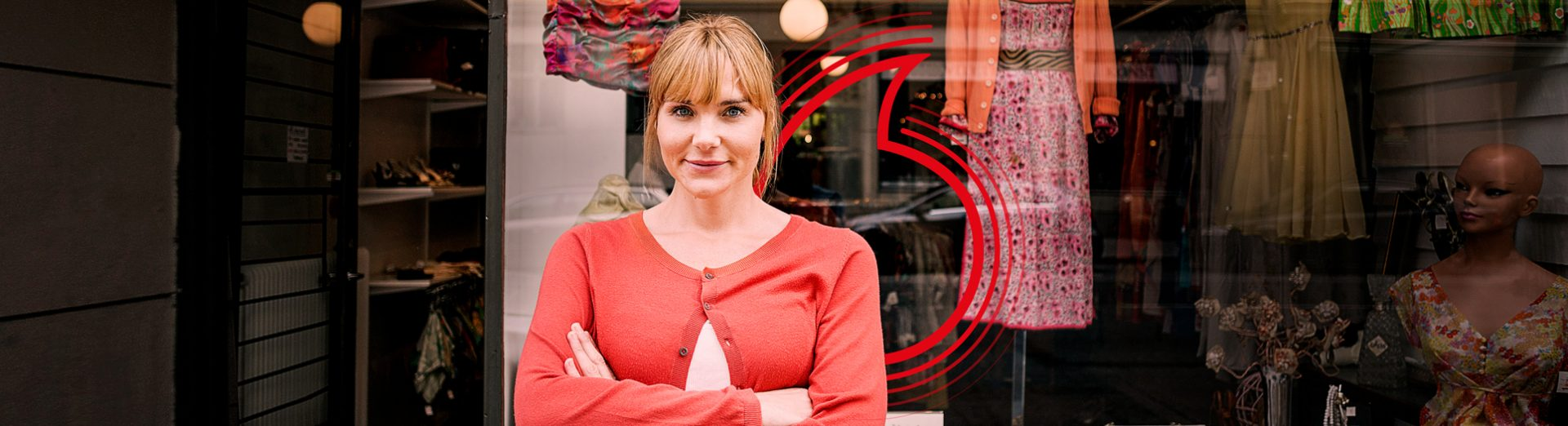 Young business woman in front of shop window