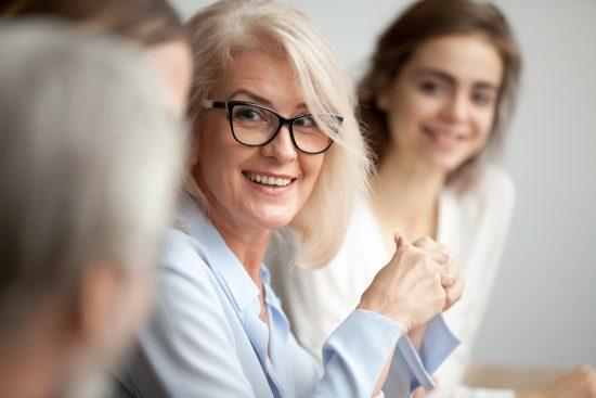 Image of older woman at a work meeting
