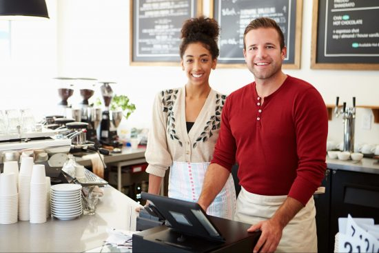 Male and female small business coffee shop owners