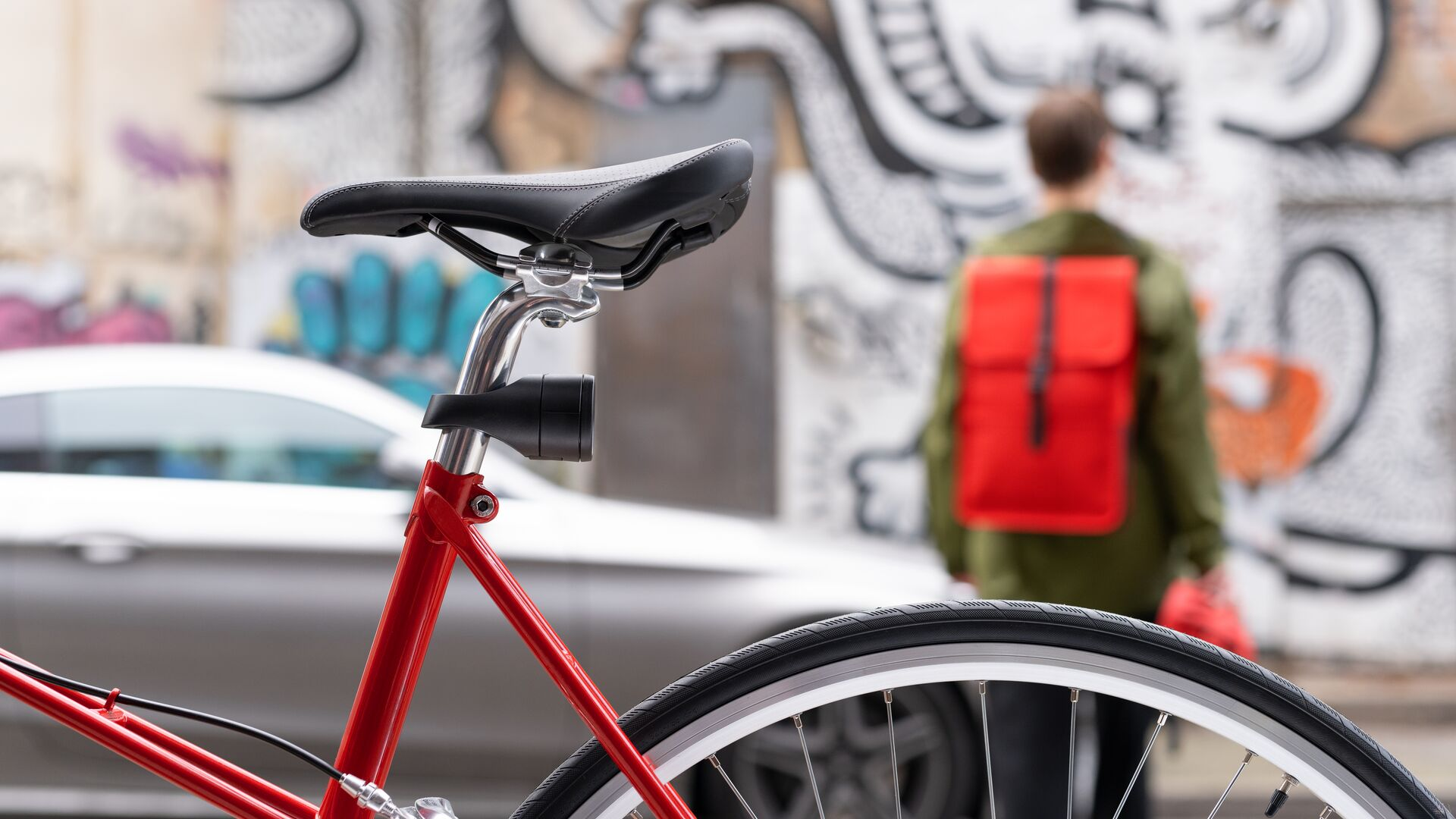 an image of the Vodafone Curve Bike tracker on a bicycle with a cyclist walking away into the background