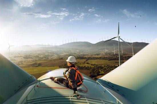 Engineer sitting on top of wind turbine