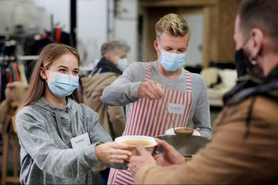 Volunteers helping in charity soup kitchen