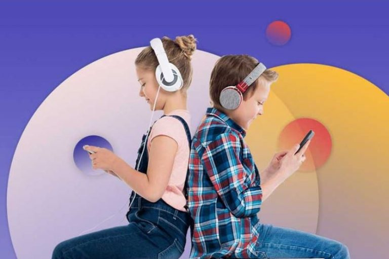 Two kids back-to-back with headphones on looking at smartphones