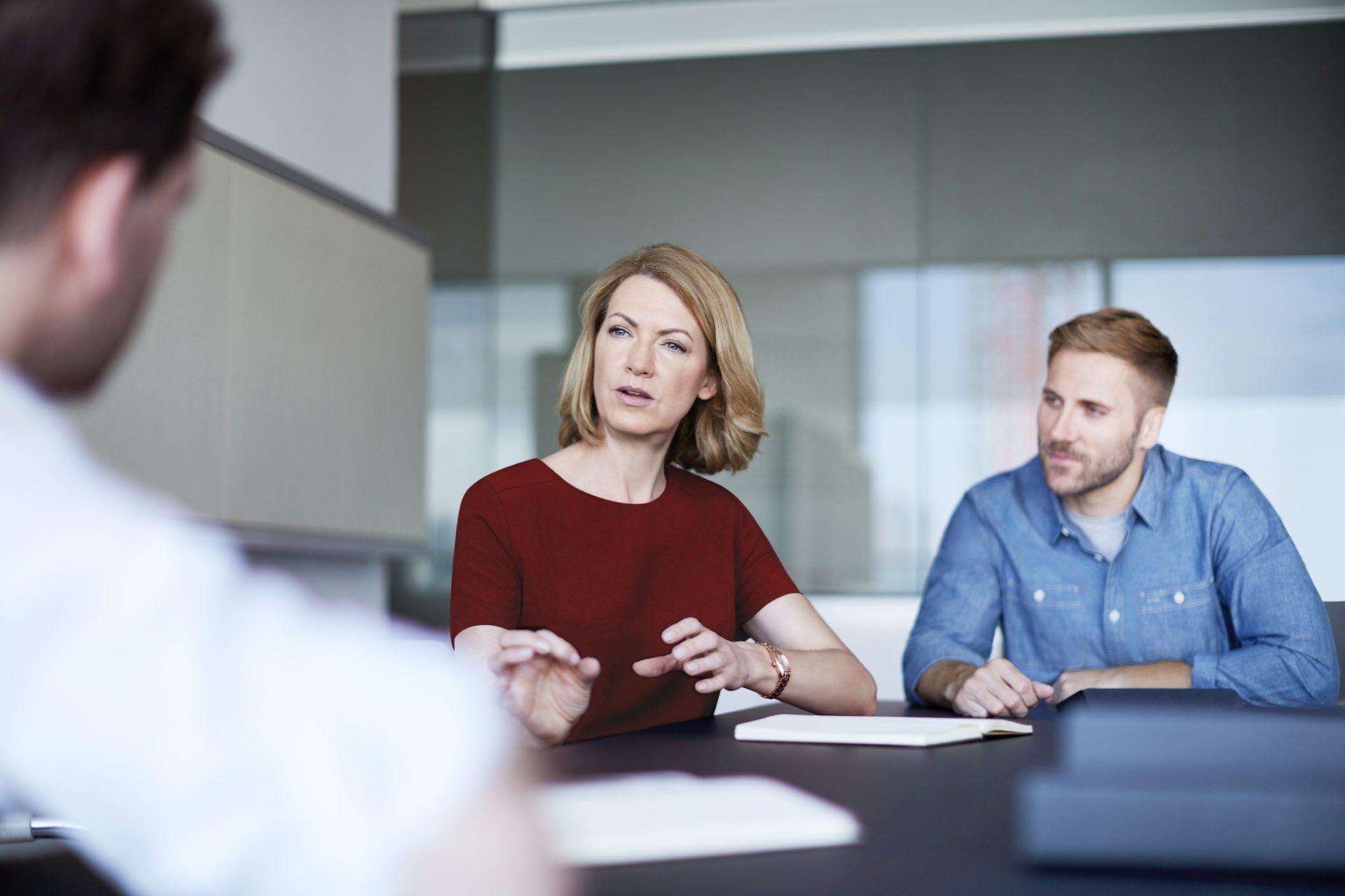 World Menopause Day - Image of businesswomen in meeting.